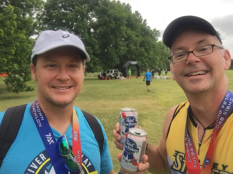 Thomas Gibson and Andy Gibb celebrate thier first duathlon finish at the 2018 Chris Brown Duathlon