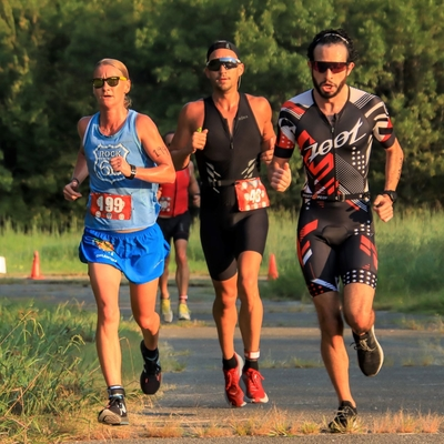 April Schroff, Jeff Goolsbay and Casper Shoghi compete in the 2020 Chris Brown Duathlon during the 5K run inside Mohawk Park