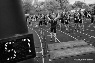 Finishers welcome other athletes at the finish line during the 2016 Spring Fever Sprint Triathlon