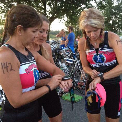 Three triathletes learn how to use new watches at the start line
