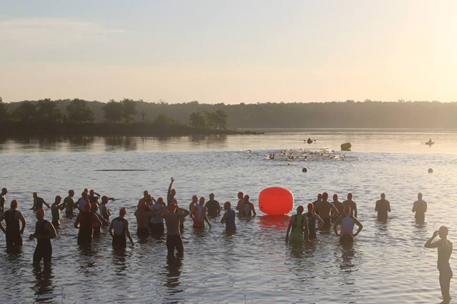 Open water swimmers starting at the Tulsa Triathlon
