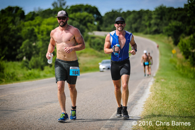 Runners race to the top of a hill at the 2016 Tulsa Triathlon